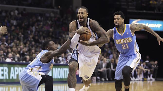 Memphis Grizzlies' James Johnson, center, protects the ball from Denver Nuggets' Nate Robinson, left, and Wilson Chandler (21) during the second half of an NBA basketball game in Memphis, Tenn., Saturday, Dec. 28, 2013. The Grizzlies defeated the Nuggets 120-99
