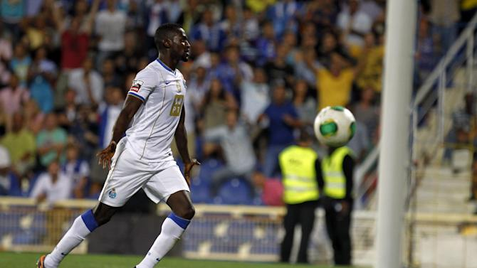 Porto's Jackson Martinez, from Colombia, celebrates after scoring his team's second goal against Estoril during their Portuguese league soccer match at the Antonio Coimbra da Mota stadium in Estoril, near Lisbon, Sunday, Sept. 22, 2013