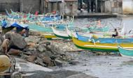 Illustration: Fishing boats sit lined up in the suburbs of Manila due to Typhoon Utor off the northern coast of Luzon island on August 12, 2013