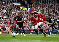 Manchester United's Robin Van Persie (R) scores a penalty against Crystal Palace during their English Premier League soccer match at Old Trafford in Manchester, northern England September 14, 2013. REUTERS/Darren Staples