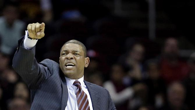 Los Angeles Clippers head coach Doc Rivers reacts during the third quarter of an NBA basketball game against the Cleveland Cavaliers, Saturday, Dec. 7, 2013, in Cleveland. The Cavaliers won 88-82