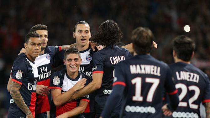Paris Saint Germain's forward Zlatan Ibrahimovic from Sweden, background center left, celebrates with his teammates, after scoring a goal, during his French League One soccer match against Monaco, at the Parc des Princes stadium, in Paris, Sunday, Sept. 22, 2013