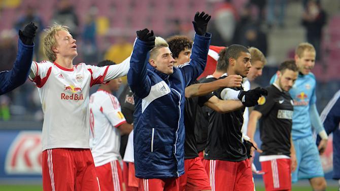 Salzburg players celebrate after  the Europa League group C soccer match  between Red  Bull Salzburg and Esbjerg fB  in Salzburg , Austria, Thursday, Dec  12, 2013. Salzburg won by 3-0