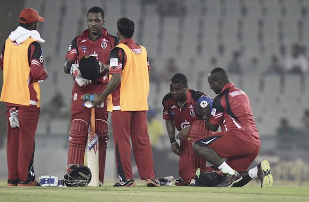 T&T batsman Evin Lewis got injured during the CLT20 match between Trinidad & Tobago and Sunrisers Hyderabad at Mohali, Chandigarh on Sept. 24, 2013. (Photo: IANS)