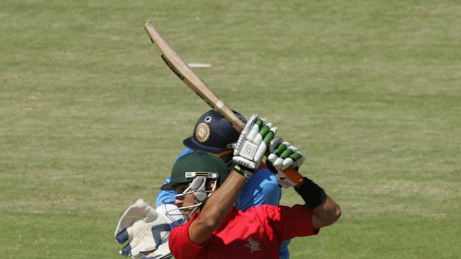 Zimbabwe batsman Sikanda Raza Butt bats during the first of the five ODI cricket series matches between India and hosts Zimbabwe at the Harare Sports Club on July 24 2013. AFP/PHOTO Jekesai Njikizana.        (Photo credit should read JEKESAI NJIKIZANA/AFP/Getty Images)