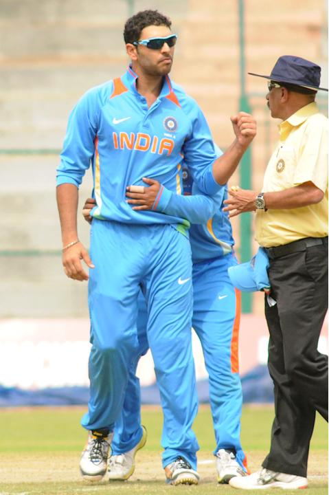Indian A team skipper Yuvraj Singh celebrates after the wicket of West Indies A team, during  India A team v/s West Indies A team unofficial T-20 cricket match at Chinnaswamy Stadium, in Bangalore on