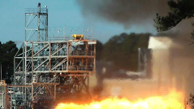 In this image taken from video, NASA engineers test fire a key part of a rocket engine left over from the 1960s-era Apollo moon missions on Thursday, Jan. 24, 2013, in Huntsville, Ala. Engineers hope to gain valuable knowledge from the engine, which was originally supposed to power the Apollo 11 moon mission in 1969 but was grounded by a problem. (AP Photo/Jay Reeves)