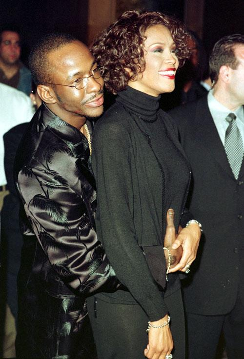 Singer Whitney Houston is embraced by her husband Bobby Brown at a party celebrating the sale of the 5 millionth copy of her latest record in New York City April 13, 1999. (Photo by Trevor Gillespie)