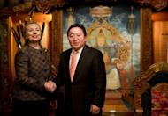 US Secretary of State Hillary Clinton (L) shakes hands with Mongolian President Tsakhia Elbegdorj at the President's Yurt in Ulan Bator on July 9. Clinton arrived in Mongolia as part of an Asian tour aimed at promoting democracy, as local politicians were locked in dispute over recent elections