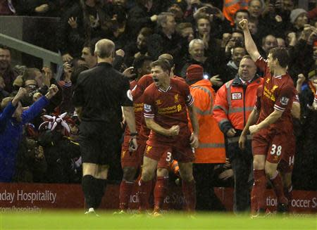 Liverpool's Gerrard celebrates after scoring a goal against Everton during their English Premier League soccer match at Anfield in Liverpool