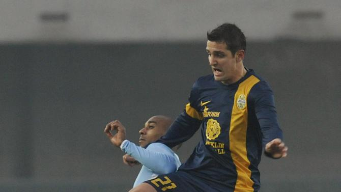 Verona's Juanito Gomez of Argentina, right, vies for the ball with Lazio's Abdoulay Konko of France, during their Serie A soccer match at Verona's Bentegodi stadium, Italy, Sunday, Dec. 22, 2013