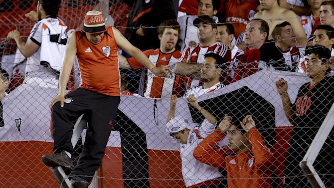 River Plate fans attend an Argentina's league soccer match against Boca Juniors in Buenos Aires, Argentina, Sunday, Oct. 6, 2013. River Plate lost 0-1