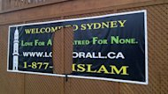 The Ahmadiyya Muslim Community welcome sign in Sydney was ripped down the middle.