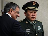 US Secretary of Defense Leon Panetta (L) and Chinese Minister of National Defense Gen. Liang Guanglie (R) participate in an honor cordon at the Pentagon. Liang was in Washington to meet for talks with top military officials in the first visit by a Chinese minister of national defense in nine years