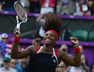 American Serena Williams celebrates after defeating Russia's Maria Sharapova in the women's singles gold medal match of the London 2012 Olympic Games, at the All England Tennis Club in Wimbledon, southwest London. Williams clinched her first Olympic singles gold medal with a 6-0, 6-1 demolition of Sharapova