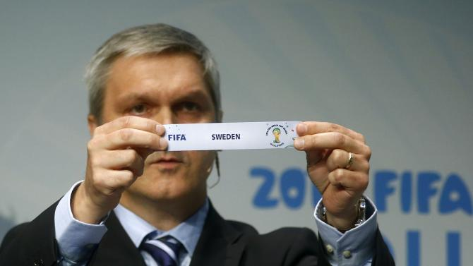 Savic head of FIFA World Cup Qualifiers displays name of Sweden during draw for 2014 World Cup European qualifying playoffs in Zurich