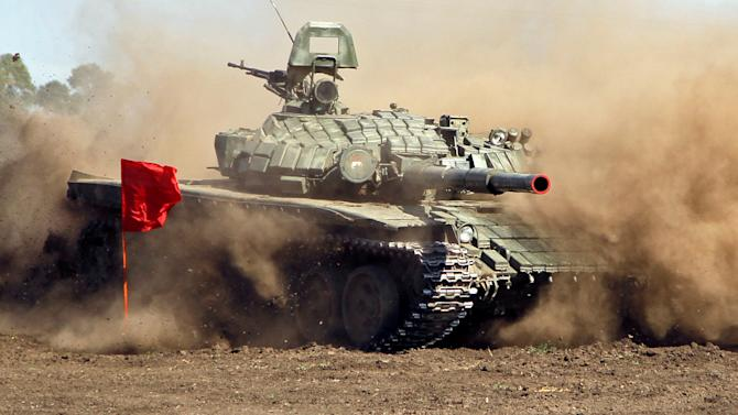 A T-72 tank drives during the Tank Biathlon competition between crews of the self-proclaimed Donetsk and the Luhansk People's Republics forces outside the town of Torez in Donetsk region