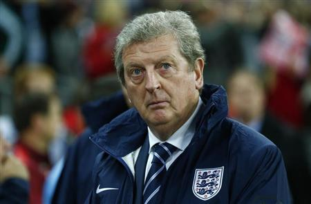 England manager Roy Hodgson watches his team before the start of their 2014 World Cup qualifying soccer match against Poland at Wembley Stadium in London