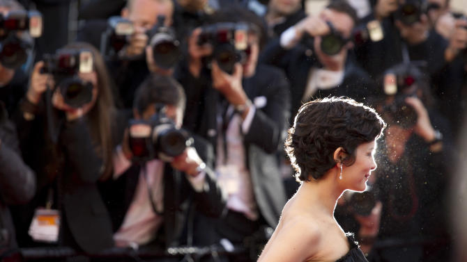 Actress Actress Audrey Tautou poses for photographers as she arrives for the screening of Venus in Fur at the 66th international film festival, in Cannes, southern France, Saturday, May 25, 2013. (AP Photo/David Azia)
