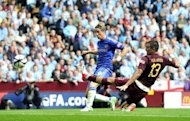 Chelsea's Spanish striker Fernando Torres scores the opening goal during their FA Community Shield football match against Manchester City at Villa Park in Birmingham, on August 12. Roberto Mancini's side are defending champions for the first time in 44 years and they are in no mood to relinquish their crown on the evidence of this vibrant display