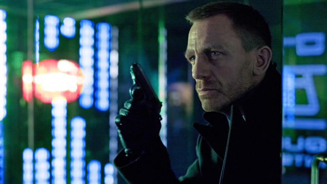 """FILE - This undated file photo released by Columbia Pictures shows Daniel Craig as James Bond in the action adventure film, """"Skyfall.""""  According to studio estimates Sunday, Dec. 9, 2012, """"Skyfall"""" took in $11 million to move back to No. 1 in its fifth weekend.  That puts it narrowly ahead of """"Rise of the Guardians,"""" the animated adventure of Santa, the Easter Bunny and other mythological heroes that pulled in $10.5 million.(AP Photo/Sony Pictures, Francois Duhamel, File)"""