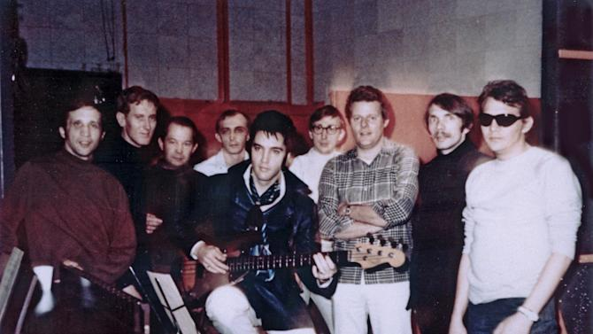 In this Jan. 22, 1969 photo provided by Elvis Presley Enterprises, Inc., Elvis Presley, center, poses for a photo at American Sound Studio with The Memphis Boys, an acclaimed studio band that worked with Elvis on two albums in 1969, in Memphis, Tenn. Bobby Wood, left, is playing in a concert in Memphis on Aug. 16, 2012 the 35th anniversary of Elvis' death in Memphis. Thousands of Elvis fans are expected to visit Graceland during Elvis Week, an annual celebration of the life of the late rock and roll icon. (AP Photo/Elvis Presley Enterprises, Inc., Robert Dye)