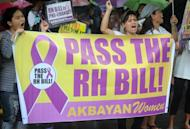 People rally outside congress in Manila on August 6, 2012 for the passage of the Reproductive Health Bill. Philippine legislators were Monday poised to pass landmark birth control laws, despite lobbying by the Catholic church, the bill's author said