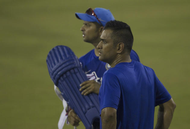 India's captain Mahendra Singh Dhoni, front and teammate Suresh Raina look on during a practice session on the eve of their second Twenty20 cricket match against South Africa in Cuttack, India, Sunday