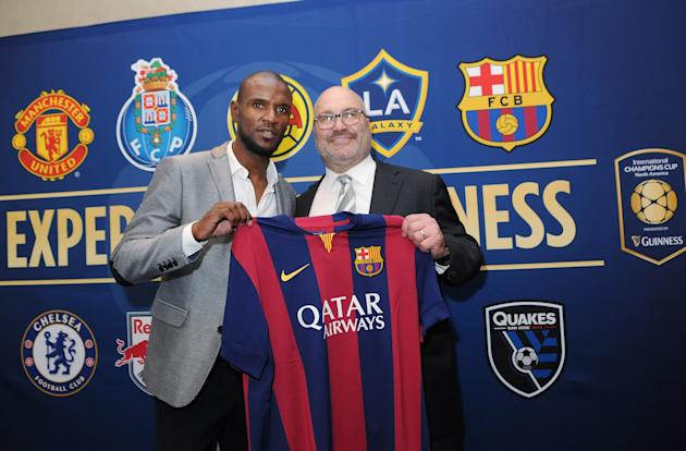 IMAGE DISTRIBUTED FOR RELEVENT SPORTS - Eric Abidal (L), of FC Barcelona, appears with Charlie Stillitano (R), chairman of Relevent Sports, during the 2015 International Champions Cup North America pr
