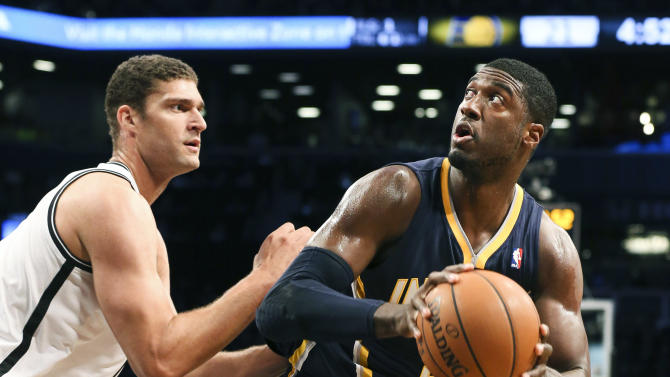 Indiana Pacers center Roy Hibbert (55) looks to shoot the ball against Brooklyn Nets center Brook Lopez (11) during the first half of an NBA basketball game against the Brooklyn Nets, Saturday, Nov. 9, 2013, at the Barclays Center in New York