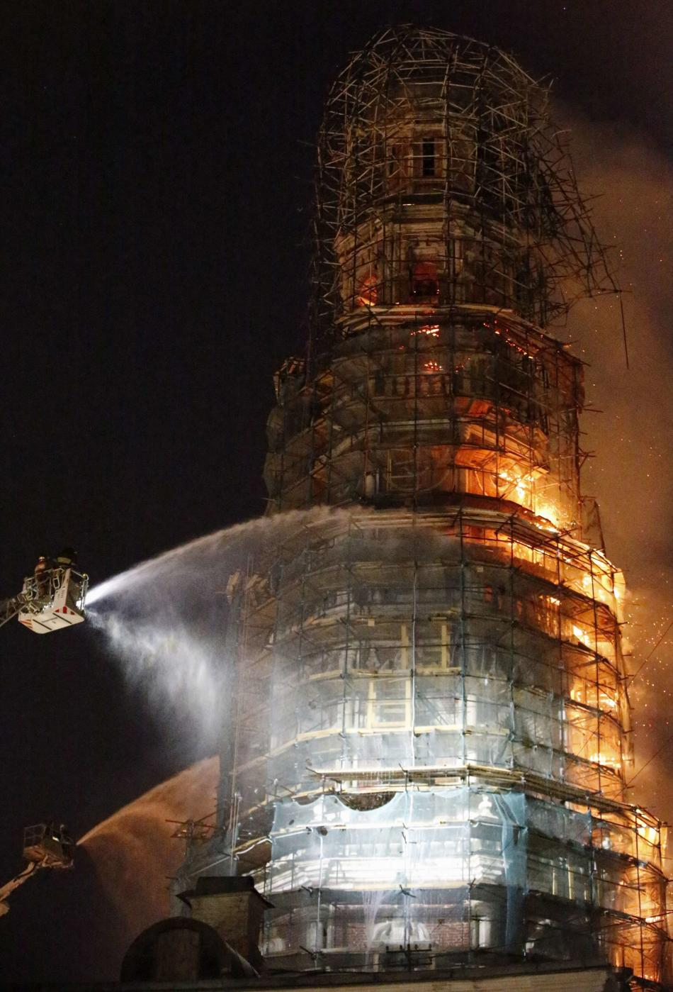 Firefighters work to extinguish a fire at the bell tower of Novodevichy monastery in Moscow