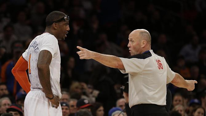 New York Knicks' Amar'e Stoudemire, left, receives a technical foul from referee David Jones during the second half of the NBA basketball game at Madison Square Garden, Sunday, March 23, 2014, in New York. The Cavaliers defeated the Knicks 106 to 100