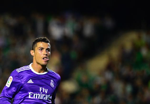 Real Madrid's Portuguese forward Cristiano Ronaldo celebrates after scoring during the Spanish league football match Real Betis vs Real Madrid CF at the Benito Villamarin stadium in Sevilla on Oct
