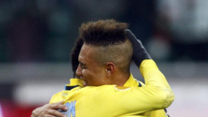 Anderson of Lazio and team mate Perea hug after their Europa League soccer match against Legia Warsaw in Warsaw