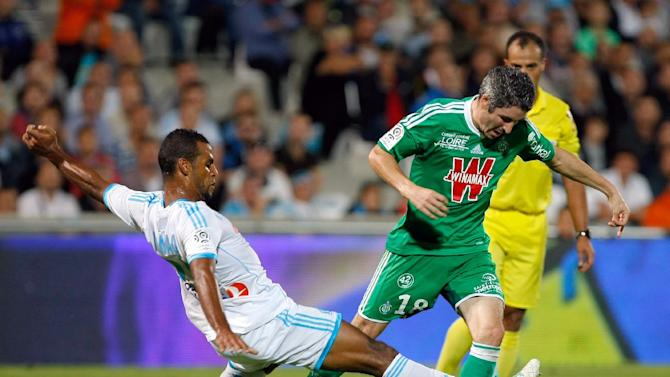 Saint-Etienne's French midfielder Fabien Lemoine, right,  challenges for the ball with Marseille's Togolese midfielder Jacques-Alaixys Romao, during their League One soccer match, at the Velodrome Stadium, in Marseille, southern France, Tuesday, Sep. 24, 2013