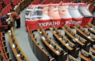 Members of Ukraine's parliamentary opposition stand by a giant placard depicting jailed former prime minister Yulia Tymoshenko. The European Union voiced deep concern Thursday over Tymoshenko, who is on a hunger strike and reportedly suffered physical violence