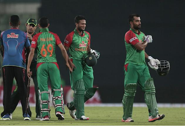 Bangladesh's Tamim Iqbal, right, and Shakib Al Hasan, second right, walk back after winning the second one-day international cricket match against Pakistan in Dhaka, Bangladesh, Sunday, April 19, 2015
