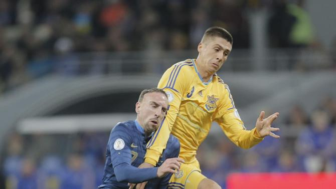 France's Franck Ribery, left, and Ukraine's Yevhen Khacheridi battle for the ball during their  2014 World Cup qualifying soccer match at the Olympiyskiy national stadium in Kiev, Ukraine, Friday, Nov. 15, 2013