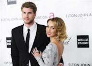 Singer Miley Cyrus (R) and actor Liam Hemsworth arrive at the 20th annual Elton John AIDS Foundation Academy Awards Viewing Party in West Hollywood, California February 26, 2012. REUTERS/Gus Ruelas/Files