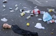 Part of a Halloween costume and rubbish at the car park of the Madrid Arena stadium in Madrid on November 1. A 17-year-old girl became the fourth person to die from being crushed in a stampede at a Halloween rave party in Madrid after she succumbed to her injuries in hospital on Saturday, Spanish media reported