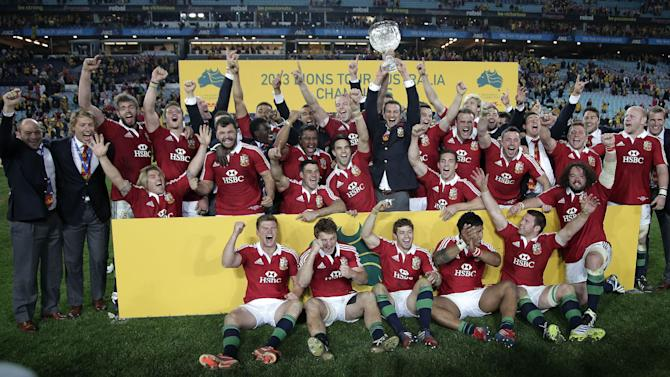 In this Saturday July 6, 2013 file photo, British and Irish Lions' team players celebrate their win over Australia in the final match of their 3-game rugby union test match series in Sydney, Australia. British Sky Broadcasting PLC sought Thursday Jan. 30, 2014 to secure its base against its insurgent rival BT PLC by securing some sports rights and a long-term deal with U.S. pay-TV network Home Box Office. The London-headquartered satellite broadcaster, said it had secured six long-term rights deals in six sports, including the 2017 rugby tour to New Zealand by the British and Irish Lions and Scottish cup football