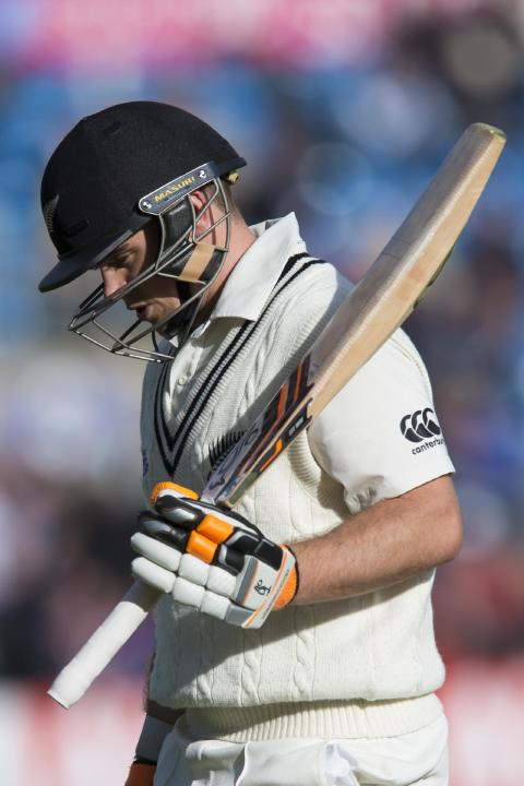 New Zealand's Tom Latham makes his way from the pitch after being caught by Joe Root on 84 off the bowling of England's Stuart Broad on the first day of the second Test match between England a