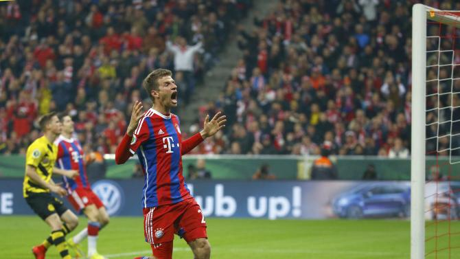 Bayern Munich's Mueller reacts after missing chance to score against Borussia Dortmund during German Cup semi-final soccer match in Munich
