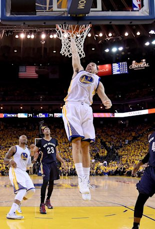 OAKLAND, CA - APRIL 20: Klay Thompson #11 of the Golden State Warriors slam dunks the ball against the New Orleans Pelicans in the third quarter during the first round of the 2015 NBA Playoffs at ORACLE Arena on April 20, 2015 in Oakland, California. NOTE TO USER: User expressly acknowledges and agrees that, by downloading and or using this photograph, User is consenting to the terms and conditions of the Getty Images License Agreement. (Photo by Thearon W. Henderson/Getty Images)