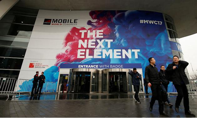 People walk past the main entrance of the Mobile World Congress in Barcelona