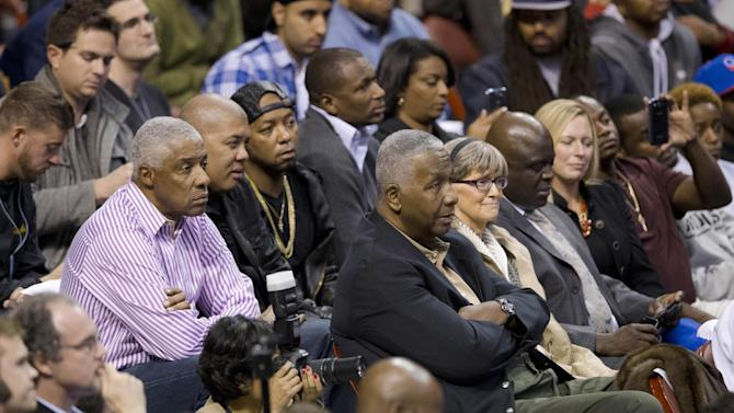 Former NBA player Julius Erving, left, in stripes, and Georgetown men's basketball coach John Thompson III, center listen to former Philadelphia 76er Allen Iverson during a news conference Wednesday, Oct. 30, 2013, in Philadelphia. Iverson officially retired from the NBA, ending a 15-year career during which he won the 2001 MVP award and four scoring titles. Iverson retired in Philadelphia where he had his greatest successes and led the franchise to the 2001 NBA finals