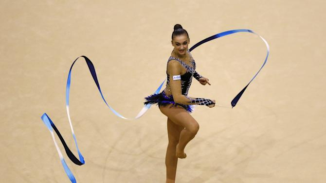 Ekaterina Volkova of Finland performs on the Rhythmic routine during the women's team competition