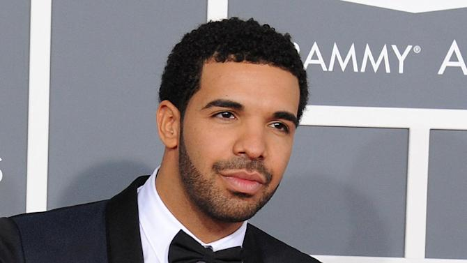 FILE - This Feb. 10, 2013 file photo shows rapper Drake at the 55th annual Grammy Awards in Los Angeles. Drake has been nominated for 12 BET Awards, Tuesday, May 14, 2013. The awards show will air live June 30 from Los Angeles' Nokia Theater L.A. Live. (Photo by Jordan Strauss/Invision/AP, file)