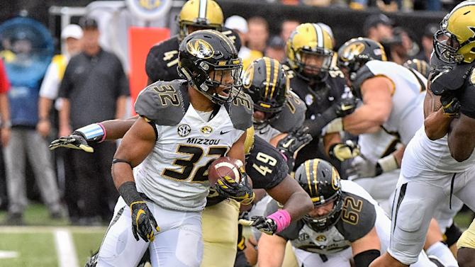 Missouri football players strike amid campus racial ...