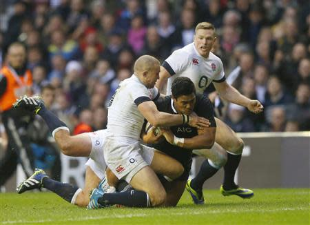 New Zealand's Savea scores a try against England during their international rugby union match at Twickenham in London